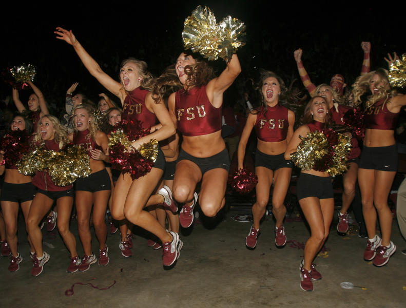 Florida State Golden Girls cheerleaders react as they watch a touchdown in the final seconds of the BCS Championship football game between Florida State and Auburn on a 30-foot screen at the Tallahassee Leon County Civic Center on Monday, Jan. 6, 2014, in Tallahassee, Fla. Florida State beat Auburn 34-31. (AP Photo/Phil Sears)