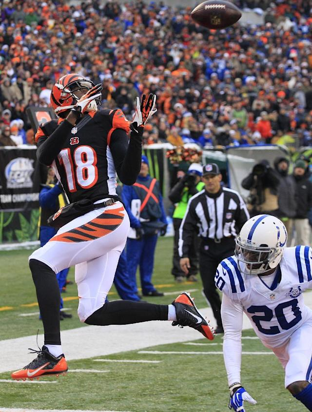 Cincinnati Bengals wide receiver A.J. Green (18) catches a 9-yard touchdown pass against Indianapolis Colts free safety Darius Butler (20) in the second half of an NFL football game, Sunday, Dec. 8, 2013, in Cincinnati. (AP Photo/Tom Uhlman)