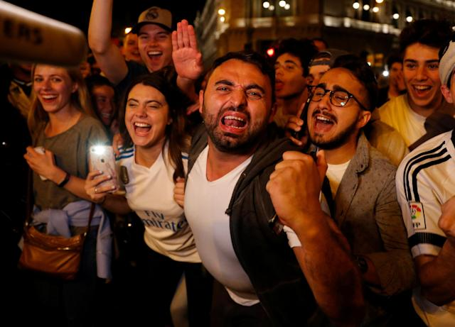 Soccer Football - Real Madrid fans watch the Champions League Final - Madrid, Spain - May 26, 2018 Real Madrid fans celebrate near the Cibeles fountain in central Madrid after their team won the Champions League REUTERS/Paul Hanna