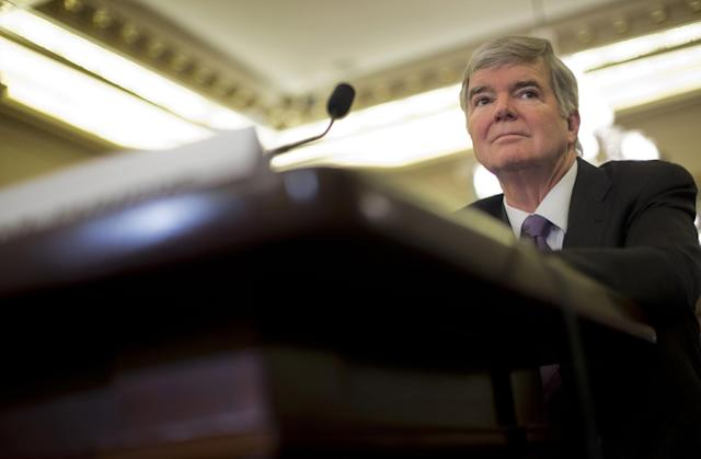 National Collegiate Athletic Association (NCAA) President Mark Emmert prepares testify on Capitol Hill in Washington, Wednesday, July 9, 2014, before the Senate Commerce hearing on the NCAA's treatment of athletes. (AP Photo/Pablo Martinez Monsivais)