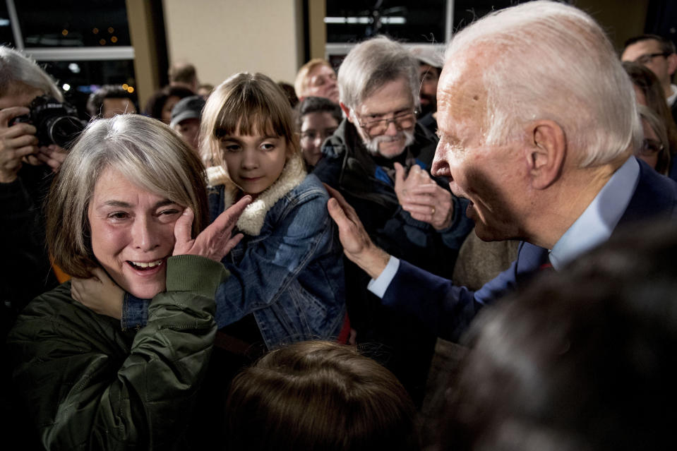 FILE - In this Jan. 5, 2020, file photo, Rose Boehle of Davenport, Iowa, becomes emotional as she and one of her granddaughters, Maddie, 7, speak with Democratic presidential candidate, former Vice President Joe Biden at a campaign rally at Modern Woodmen Park in Davenport, Iowa. Boehle is raising her granddaughters after her daughter overdosed on opioids. Though Biden's campaign has a policy paper on addiction, the issue has barely registered in this year's presidential campaign, overshadowed by the human and economic toll of the coronavirus outbreak and the Trump administration's response to the pandemic. (AP Photo/Andrew Harnik, File)
