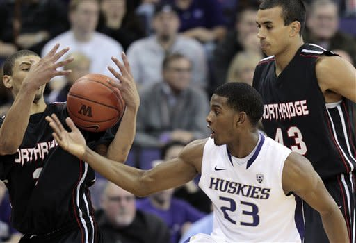 Cal State Northridge's Stephan Hicks, left, battles for a loose ball with Washington's C.J. Wilcox (23) as Cal State Northridge's John Hayward-Mayhew (43) looks on in the first half of an NCAA college basketball game on Thursday, Dec. 22, 2011, in Seattle. (AP Photo/Elaine Thompson)