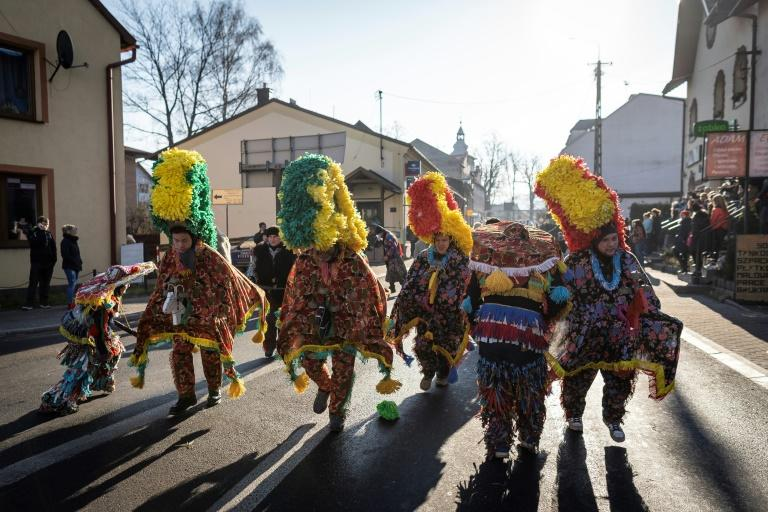 Colourful and loud, the festival, with its time-honoured traditions, brings together inhabitants of villages nestled in the foothills of Poland's southern Beskid mountain range (AFP Photo/Wojtek RADWANSKI)