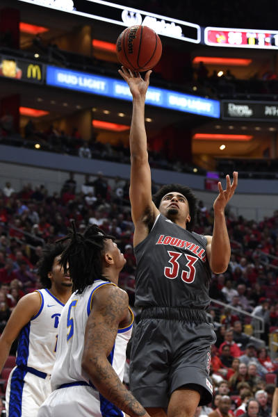 Louisville forward Jordan Nwora (33) goes in for a layup past the defense of Pittsburgh guard Au'Diese Toney (5) during the second half of an NCAA college basketball game in Louisville, Ky., Friday, Dec. 6, 2019. (AP Photo/Timothy D. Easley)