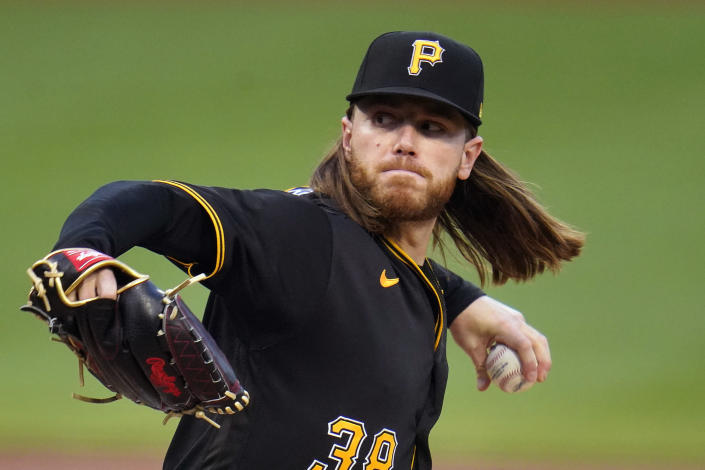 Pittsburgh Pirates starting pitcher Dillon Peters delivers during the first inning of a baseball game against the Cincinnati Reds in Pittsburgh, Tuesday, Sept. 14, 2021. (AP Photo/Gene J. Puskar)