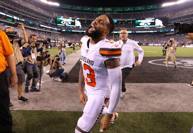 Odell Beckham runs off the field after defeating the New York Jets. (Getty Images)