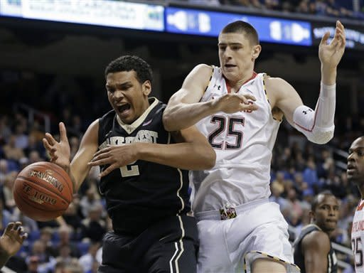 Wake Forest's Devin Thomas (2) and Alex Len (25) vie for a rebound during the first half of an NCAA college basketball game at the Atlantic Coast Conference tournament in Greensboro, N.C., Thursday, March 14, 2013. (AP Photo/Gerry Broome)