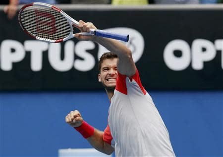 Grigor Dimitrov of Bulgaria celebrates defeating Milos Raonic of Canada during their men's singles match at the Australian Open 2014 tennis tournament in Melbourne January 18, 2014. REUTERS/Bobby Yip