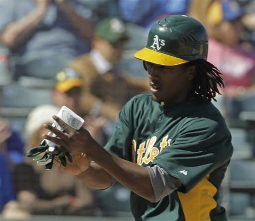 Oakland Athletics' Jemile Weeks reacts after scoring during the first inning of a spring training baseball game against the Seattle Mariners, Friday, March 2, 2012, in Phoenix. (AP Photo/Darron Cummings)
