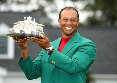 Golf - Masters - Augusta National Golf Club - Augusta, Georgia, U.S. - April 14, 2019. Tiger Woods of the U.S. celebrates with with his green jacket and trophy after winning the 2019 Masters. REUTERS/Lucy Nicholson