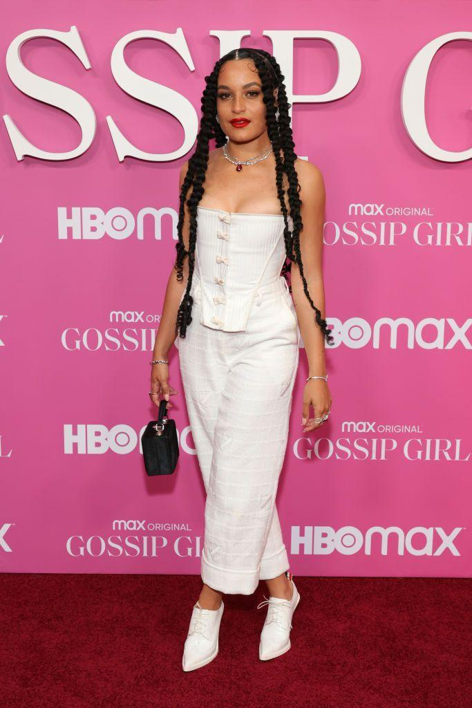 <p>Director Evans wore a white two-piece by Thom Browne. </p>