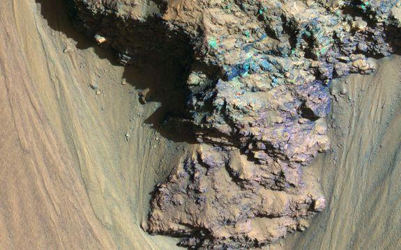 An enhanced color image of a part of Mars' massive valley, Valles Marineris.