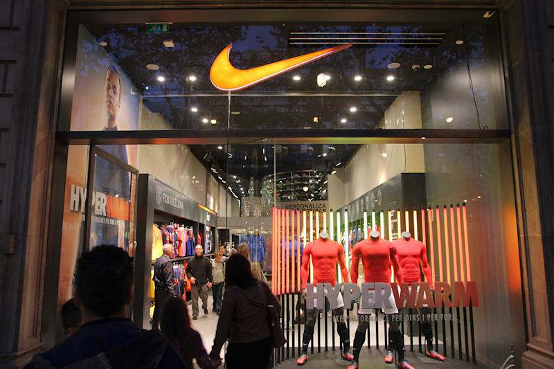 Barcelona, Spain - November 6, 2012: Customers visit Nike store on November 6, 2012 in Barcelona, Spain. Nike is one of most recognized fashion brands. It exists since 1964 and had US$ 19 billion revenue (2010).