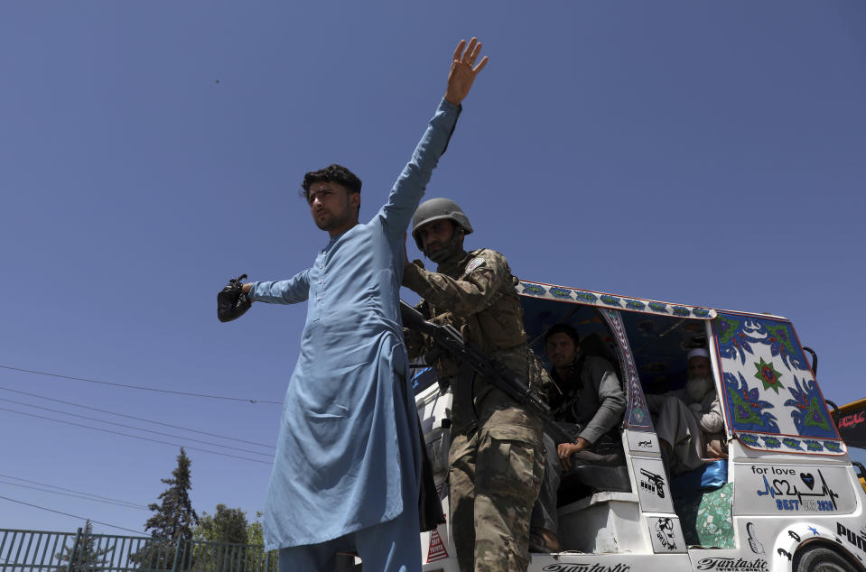 Afghan security police search a man at a checkpoint in Jalalabad, Afghanistan, Wednesday, April 21, 2021. America is winding up its longest war, calculating that the terrorist threat out of Afghanistan can't reach to its shores and that threats to the West by militants can be defused from a distance. (AP Photo/Rahmat Gul)