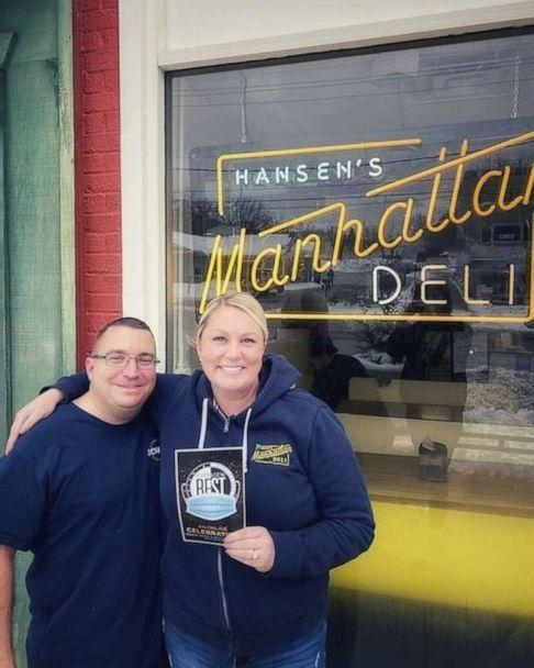 PHOTO: Carey Hansen and her husband Corey stand outside their deli in Des Moines, Iowa, in January. (Courtesy Carey Hansen)