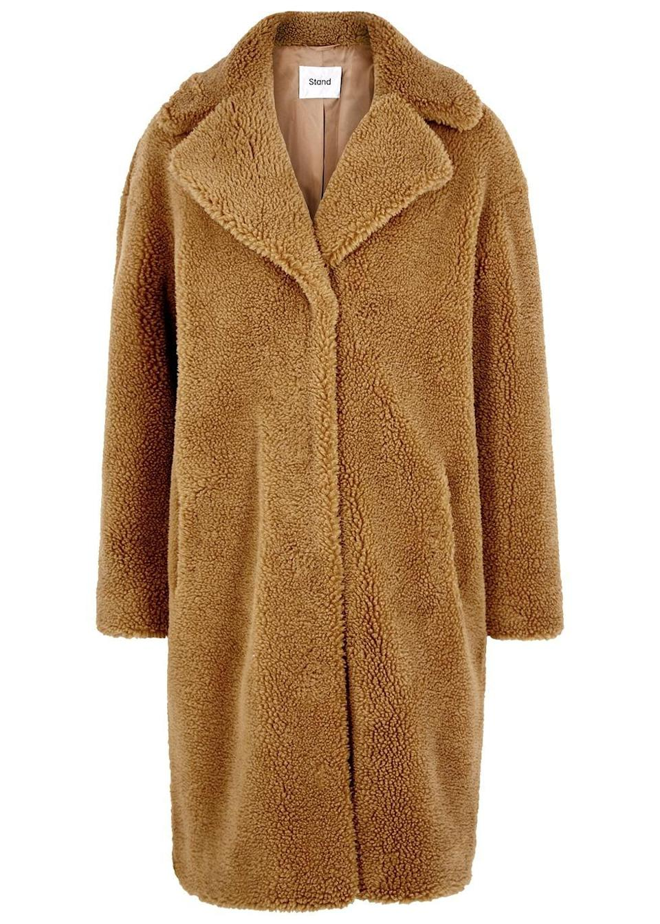 """<p><a class=""""link rapid-noclick-resp"""" href=""""https://www.harveynichols.com/brand/stand/284482-camille-brown-faux-shearling-coat/p3217050/"""" rel=""""nofollow noopener"""" target=""""_blank"""" data-ylk=""""slk:SHOP NOW"""">SHOP NOW</a></p><p>The teddy coat is a whole category in itself, of course, but we couldn't resist adding this cosy Staud version into our round-up. Cut in an oversized shape from tactile faux shearling, it's detailed with generous lapels and has concealed snap fastenings through the front.</p><p>Camille Camel Teddy Coat, £260, Stand Studio</p>"""