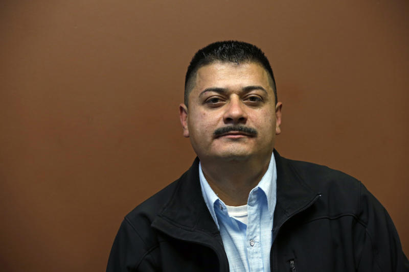 FILE - In this Friday, Oct. 17, 2014 file photo, Ignacio Lanuza-Torres sits for a portrait in Seattle. Lanuza-Torres, a Mexican immigrant who was nearly deported after a U.S. Immigration and Customs Enforcement lawyer forged a key document in his case, accomplished a fair amount by suing over the misconduct. The lawsuit helped prompt a criminal investigation that sent the lawyer to jail, established legal precedent concerning constitutional rights during immigration proceedings, and resulted in a small settlement from the lawyer. But the case failed in its effort to hold the federal government liable for its lawyer's actions, and now the Justice Department is trying to squeeze him and his attorneys for legal fees and costs that will likely top $100,000.(AP Photo/Elaine Thompson, File)