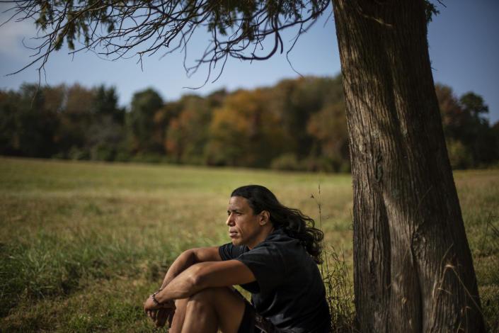 """Annawon Weeden, 46, a member of the Mashpee Wampanoag Tribe, sits for a portrait outside his home in Oakdale, Conn., Friday, Sept. 25, 2020. """"How do you pay somebody for that?"""" said Weeden when asked if governments should make financial reparations to Native people. """"The most valuable thing anyone can have or possess ever is time and you don't get that time back. I don't get my ancestors back. It's degrading to think that you could buy your way out of what you put us in. Actions speak for themselves,"""" Weeden said. """"You don't got to pay me a dime. Clean up your community, show some respect. Pay the land the respect. It's never about me. It's about this land. I'm only here for a short time. This land had to last a lot longer. Your children are going to have to inherit this. What do you want to leave them? Let's look about our children and how our children's lives are going to turn out because if we can't get things to go better for them, we've all failed."""" (AP Photo/David Goldman)"""