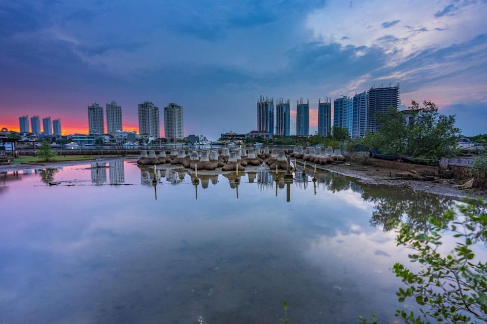 """It's well known that Venice is sinking, but it turns out that Indonesia's capital of North Jakarta might also be going under. Due to rising sea levels and sinking land, which is a result of <a href=""""https://bestlifeonline.com/climate-change-affects-health/?utm_source=yahoo-news&utm_medium=feed&utm_campaign=yahoo-feed"""" rel=""""nofollow noopener"""" target=""""_blank"""" data-ylk=""""slk:climate change"""" class=""""link rapid-noclick-resp"""">climate change</a>, 95 percent of the area might be <a href=""""https://www.wired.com/story/jakarta-is-sinking/"""" rel=""""nofollow noopener"""" target=""""_blank"""" data-ylk=""""slk:submerged by 2050"""" class=""""link rapid-noclick-resp"""">submerged by 2050</a>, according to a report by <em>Wired</em>."""