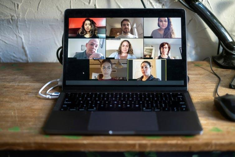 A laptop with a Zoom meeting in progress