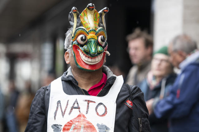 <p>A disguised protestor attends a rally to mark the International Labor Day, in Zurich, Switzerland, on May 1, 2018. (Photo: Patrick Huerlimann/Keystone via AP) </p>