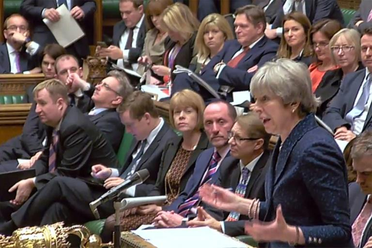 Theresa May imparting 'good news' to lawmakers