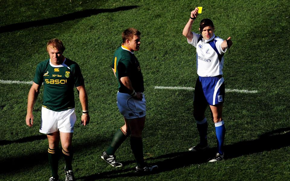 Christophe Berdos shows a yellow card to Schalk Burger - GETTY IMAGES