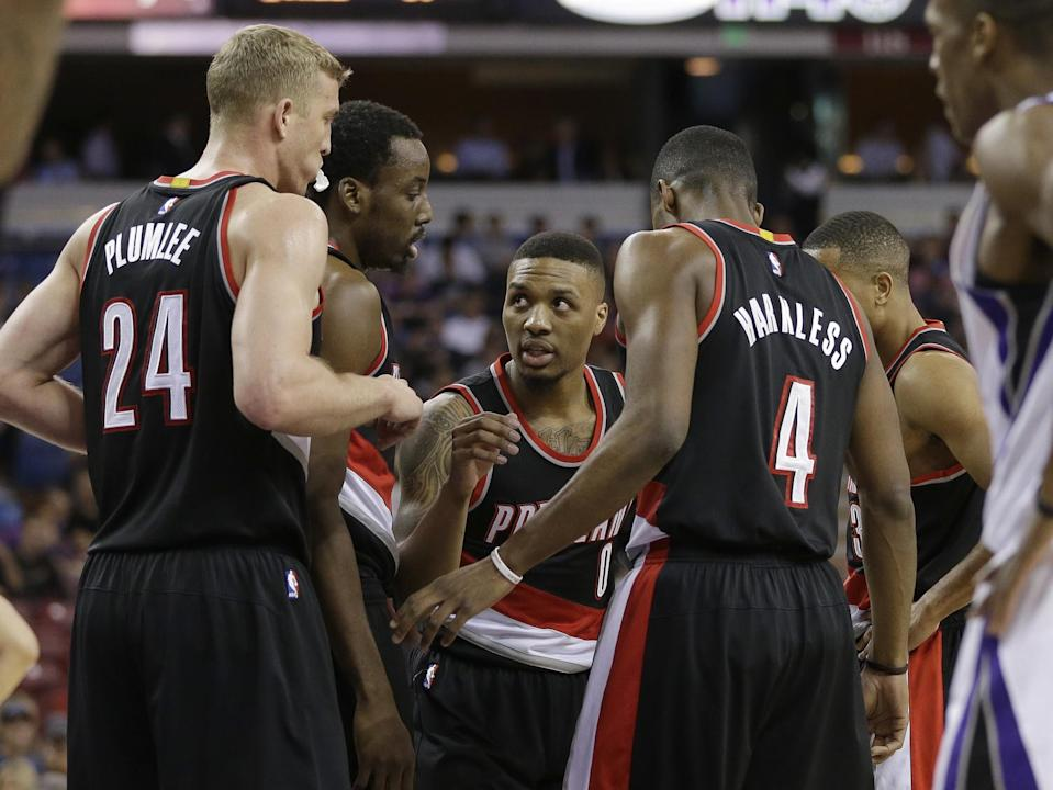 For the Portland Trail Blazers, everything revolves around Damian Lillard (center) and C.J. McCollum. (AP/Rich Pedroncelli)