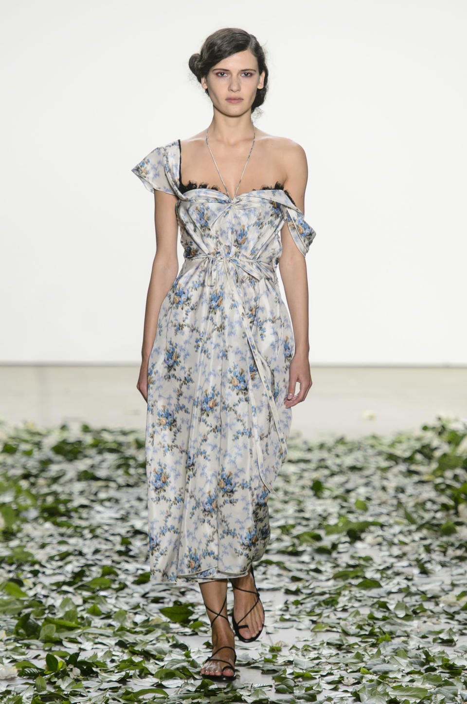 <p><i>Model wears a one-shoulder, floral-print dress from the SS18 Brock Collection. (Photo: ImaxTree) </i></p>