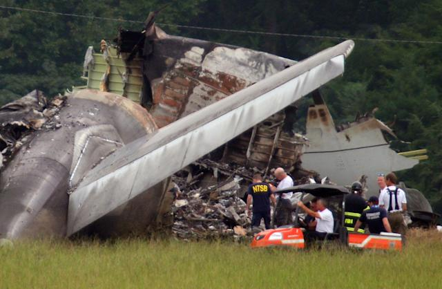 NTSB investigators work around the tail section of the UPS cargo plane that crashed on approach to the Birmingham-Shuttlesworth International Airport August 15, 2013 in Birmingham, Ala. The Airbus A300 jet headed from Louisville, Ky., to Birmingham, Ala., landed in a field near the Birmingham-Shuttlesworth Airport around daybreak Wednesday, killing the two pilots on board and scattering wreckage over a wide area. (Photo/Hal Yeager)