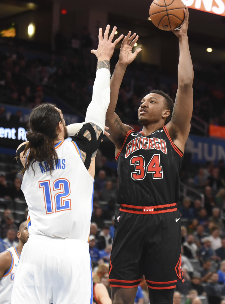 Chicago Bulls center Wendall Carter Jr. (34) shoots the ball over Oklahoma City Thunder center Steven Adams (12) in the first half of an NBA basketball game, Monday, Dec. 16, 2019, in Oklahoma City. (AP Photo/Kyle Phillips)