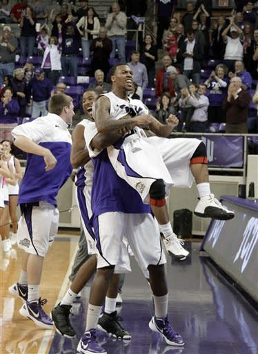 TCU's Hank Thorns, front, celebrates with teammates following their 102-97 win in overtime of an NCAA college basketball game against UNLV on Tuesday, Feb. 14, 2012, in Fort Worth, Texas. (AP Photo/Tony Gutierrez)