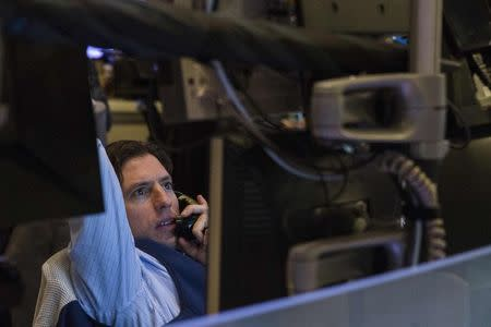A trader watches the screen at his terminal on the floor of the New York Stock Exchange in New York October 15, 2014.  REUTERS/Lucas Jackson