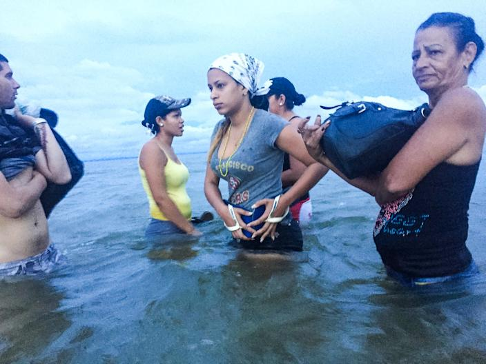 June 6, 2016 - Liset and Marta prepare to board a boat at dawn to go from Necocli to Capuragna in Colombia, getting closer to the Panamanian border. (Photo: Lisette Poole)
