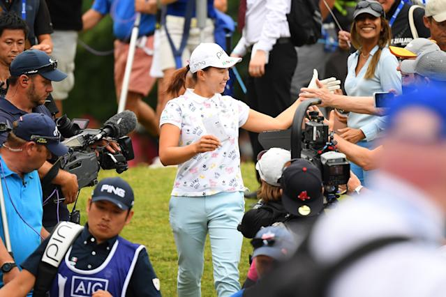 "<h1 class=""title"">hinako shibuno AIG Women's British Open - Day Four</h1> <div class=""caption""> WOBURN, ENGLAND - AUGUST 04: Hinako Shibuno of Japan interacts with the crowd during Day Four of the AIG Women's British Open at Woburn Golf Club on August 04, 2019 in Woburn, England. (Photo by Jan Kruger/WME IMG/WME IMG via Getty Images) </div> <cite class=""credit"">Jan Kruger/WME IMG</cite>"