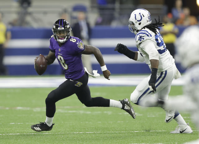 Baltimore Ravens quarterback Lamar Jackson (8) scrambles away form Indianapolis Colts defensive end Denico Autry (95) in the first half of an NFL preseason football game in Indianapolis, Monday, Aug. 20, 2018. (AP Photo/Darron Cummings)