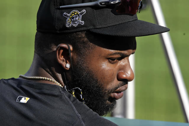 Pittsburgh Pirates Gregory Polanco stands in the dugout during a simulated game at the baseball team's training in Pittsburgh, Wednesday, July 8, 2020. (AP Photo/Gene J. Puskar)