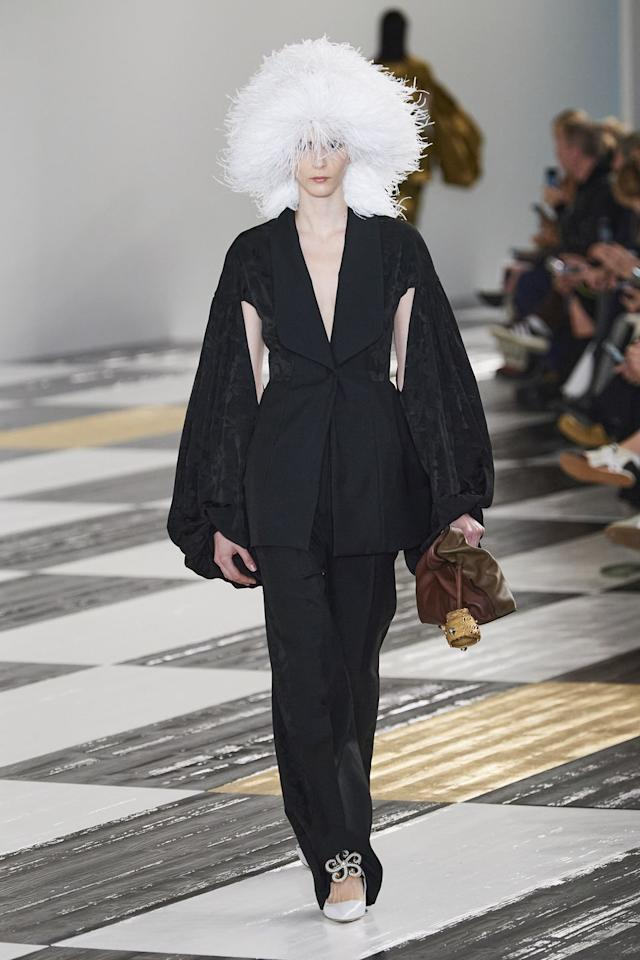 <p>The perfect evening suit is reimagined with brocade and a dramatic sleeve. This season, British designer Jonathan Anderson collaborated with Japanese artist Takuro Kuwata for the Spanish house of Loewe, in Paris. The result: beautiful organic ceramics added to the flamenco clutch in a beautiful melding of cultures and styles. —<em>Nicole Fritton, Executive Fashion Director</em></p>