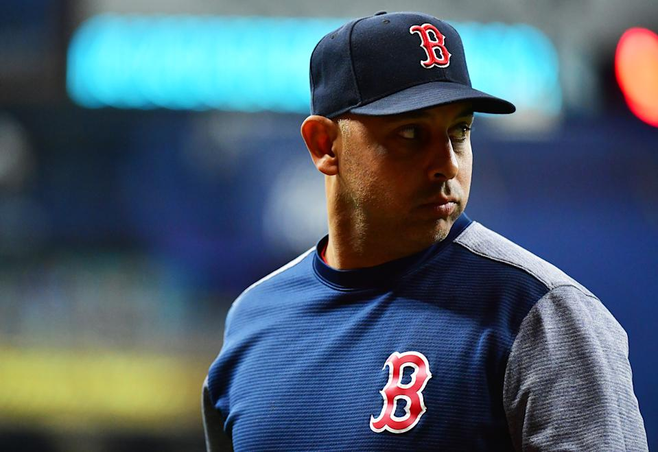 ST PETERSBURG, FLORIDA - SEPTEMBER 20: Manager Alex Cora #20 of the Boston Red Sox looks back after relieving a pitcher against the Tampa Bay Rays at Tropicana Field on September 20, 2019 in St Petersburg, Florida. (Photo by Julio Aguilar/Getty Images)
