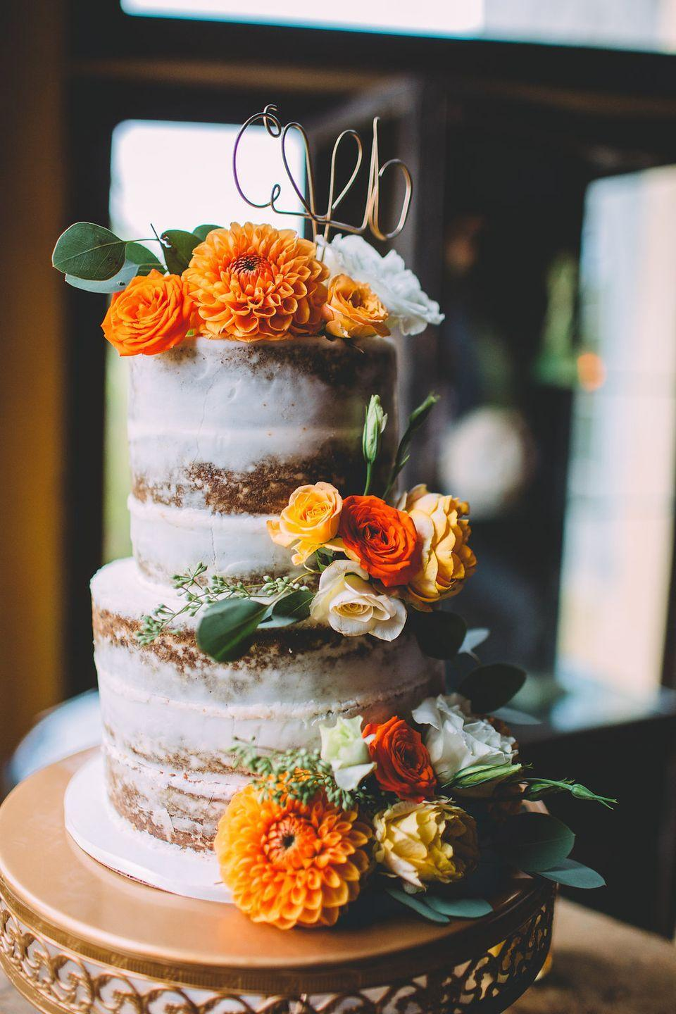 """<p>The clusters of orange and yellow roses and zinnias by <a href=""""https://www.poppyhillflowers.com/"""" rel=""""nofollow noopener"""" target=""""_blank"""" data-ylk=""""slk:Poppyhill Flowers"""" class=""""link rapid-noclick-resp"""">Poppyhill Flowers</a> on this <a href=""""http://frostitcakery.com/"""" rel=""""nofollow noopener"""" target=""""_blank"""" data-ylk=""""slk:Frost It Cakery"""" class=""""link rapid-noclick-resp"""">Frost It Cakery</a> creation.</p>"""