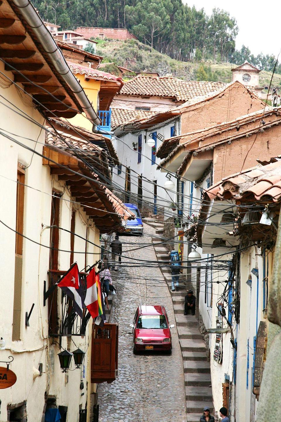 """<p><strong>Where To Stay:</strong> Most travellers bunk up in Aguas Calientes when visiting Machu Picchu. The hotels there are relatively low-key and sparse. For a clean, safe bet, try <a href=""""http://flowersmachupicchu.com/"""" rel=""""nofollow noopener"""" target=""""_blank"""" data-ylk=""""slk:Hotel Flower's House"""" class=""""link rapid-noclick-resp"""">Hotel Flower's House</a>, which has rooms for around £60 per night, including breakfast. It's located near the train station and walking distance from all the restaurants in town.</p><p><strong>Insider Tip:</strong> On your way back, stop to see Cusco, a UNESCO World Heritage city located 11,000 feet above sea level. For dinner, head to <a href=""""https://www.cicciolinacuzco.com/"""" rel=""""nofollow noopener"""" target=""""_blank"""" data-ylk=""""slk:Cicciolina"""" class=""""link rapid-noclick-resp"""">Cicciolina</a>, a Peruvian tapas restaurant located in one of the city's old colonial houses.</p><span class=""""copyright"""">Photo: Ramona Settle / Alamy. </span>"""
