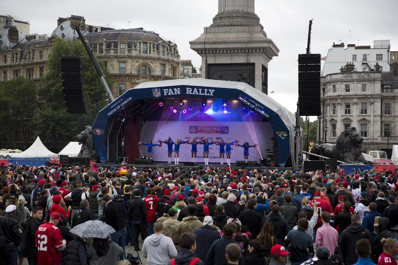 Cheerleaders perform on stage during an NFL fan rally in Trafalgar Square, London, Saturday, Oct. 26, 2013. The San Francisco 49ers are due to play the the Jacksonville Jaguars at Wembley stadium in London on Sunday, Oct. 27 in a regular season NFL game. (AP Photo/Matt Dunham)