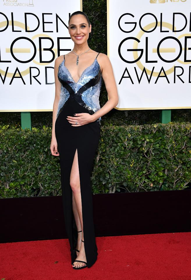 <p>Gal Gadot didn't let her pregnant belly keep her from flashing some leg with a high slit in her Mugler gown. (Photo: Getty Images) </p>