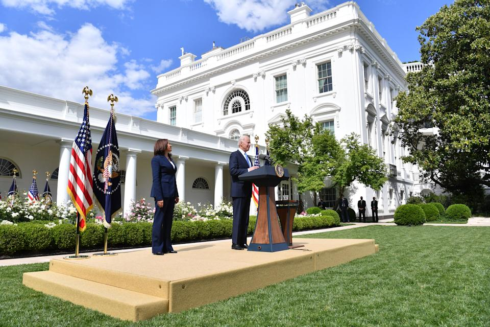 US President Joe Biden delivers remarks on Covid-19 response and the vaccination program, from the Rose Garden of the White House, Washington, DC on May 13, 2021, as US Vice President Kamala Harris looks on. (Photo by Nicholas Kamm / AFP) (Photo by NICHOLAS KAMM/AFP via Getty Images)