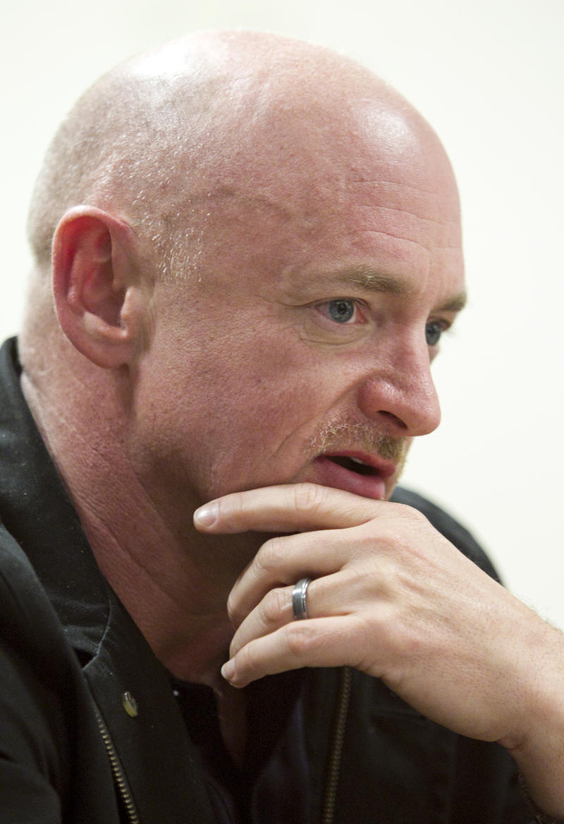 Mark Kelly, husband of Rep. Gabrielle Giffords, talks about his life with Gabby Tuesday, Jan. 18, 2011 at the University Medical Center in Tucson, Az. (AP Photo/The Arizona Republic, Tom Tingle)  MARICOPA COUNTY OUT; MAGS OUT; NO SALES