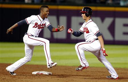 Braves Simmons is chased by teammate Upton in celebration after Simmons hit a single knocking in the winning run against the Brewers in the ninth inning at their MLB National League baseball game in Atlanta