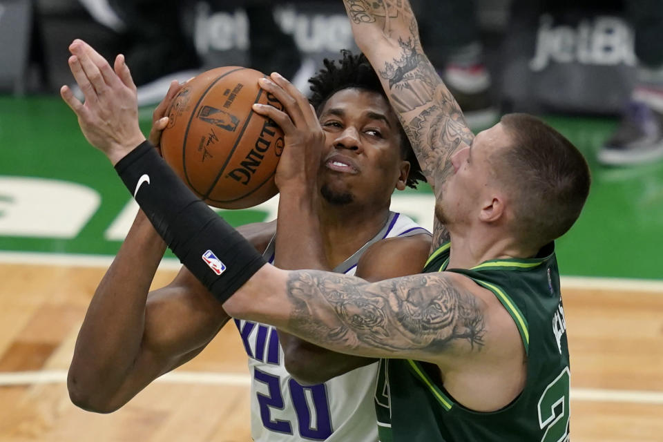 Sacramento Kings center Hassan Whiteside (20) makes a move against Boston Celtics center Daniel Theis, right, in the first half of an NBA basketball game, Friday, March 19, 2021, in Boston. (AP Photo/Elise Amendola)