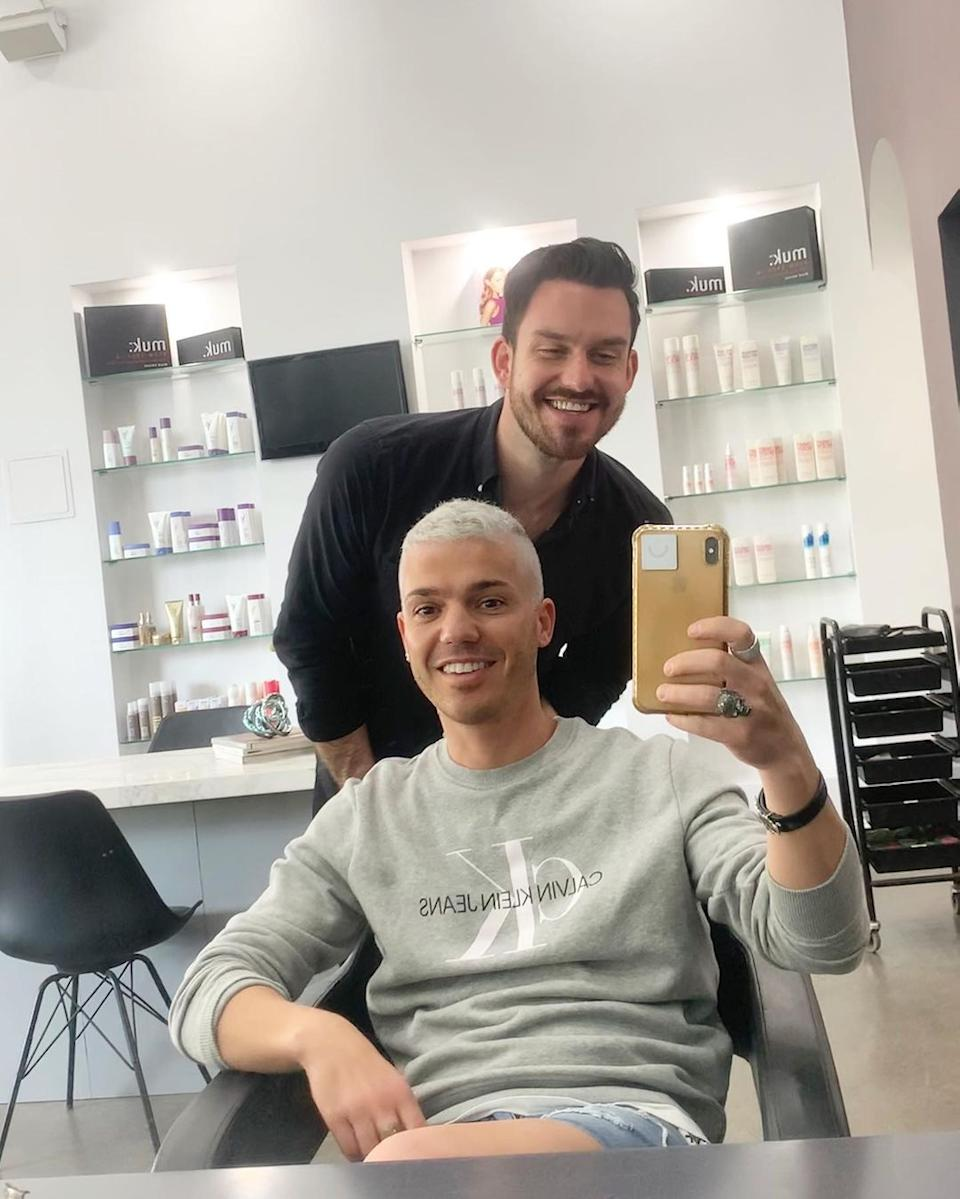 Anthony Callea takes a selfie at a hairdressers after having his hair bleached blonde