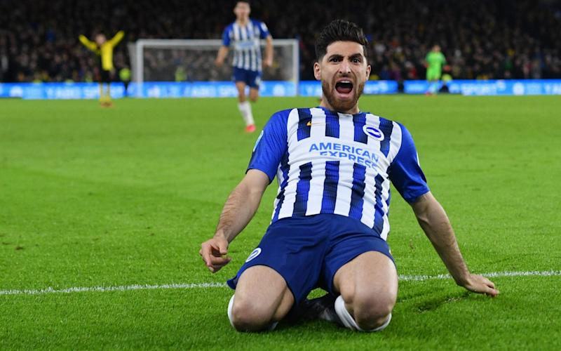 Brighton's Iranian midfielder Alireza Jahanbakhsh celebrates after Watford's English-born Jamaican defender Adrian Mariappa scores an own goal during the English Premier League football match between Brighton and Hove Albion and Watford - AFP