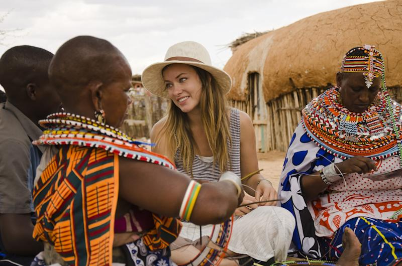 """This undated image provided by PBS shows actress Olivia Wilde in Kenya. Wilde, America Ferrara, and Meg Ryan are among the actresses who brought their star power to the PBS documentary """"Half the Sky,"""" which details efforts to help exploited women worldwide. It airs Monday and Tuesday, Oct. 1-2. (AP Photo/PBS, Jessica Chermayeff)"""